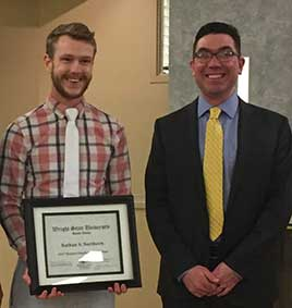 Photo of Student Employee of the Year Nathan Northern, holding certificate, posing next to supervisor Kirby Underwood.