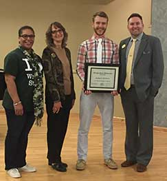 Photo of Nathan Northern posing with selection committee member Harolynn Williams, pre-health advisor-College of Science & Math; Carleen Beckermann, Student Employment manager, Career Center; Skip Rinehart, coordinator, Student Employee of the Year award.