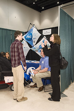 photo of a student communicating with a recruiter at a career event
