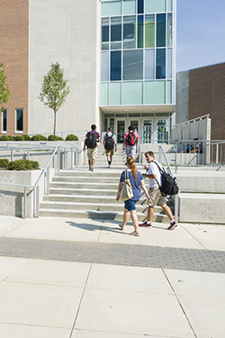photo of students walking into a campus building