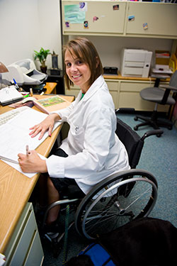 photo of a faculty member working at a desk