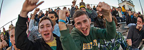 photo of students cheering at a soccer game
