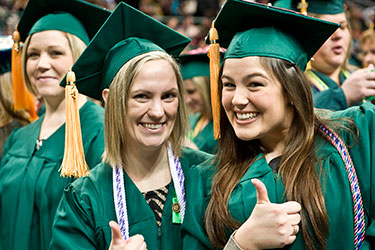 photo of two women at commencement