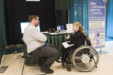 photo of a student speaking to a recruiter at a career event