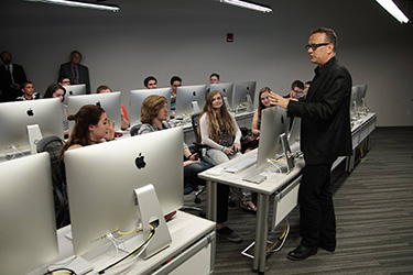 photo of tom hanks and students in the tom hanks center for motion pictures