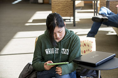 photo of a student using a tablet