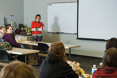 photo of a professor and students in a classroom