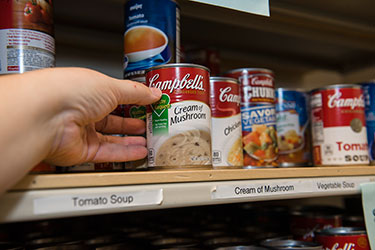 photo of products on a shelf in the food pantry