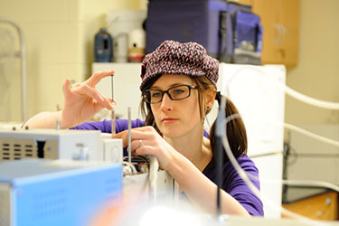 photo of a student working in a lab