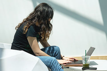 photo of a student using a laptop