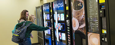 photo of a students using a vending machine