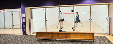 photo of two people playing raquetball