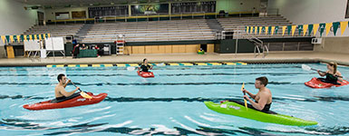 photo of people kayaking in the pool