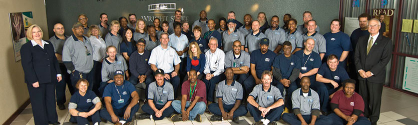 photo of physical plant employees with president hopkins