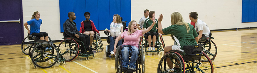photo of students playing wheelchair basketball