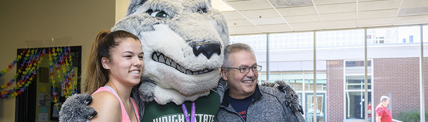 photo of a student and father with Rowdy