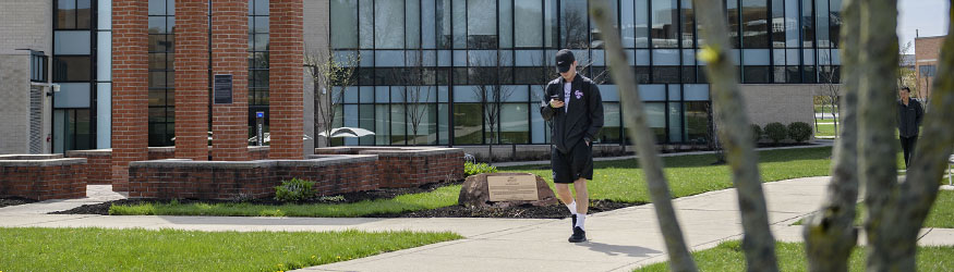 photo of a student walking on campus