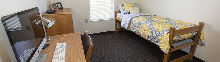 photo of a bedroom in a college or university park apartment