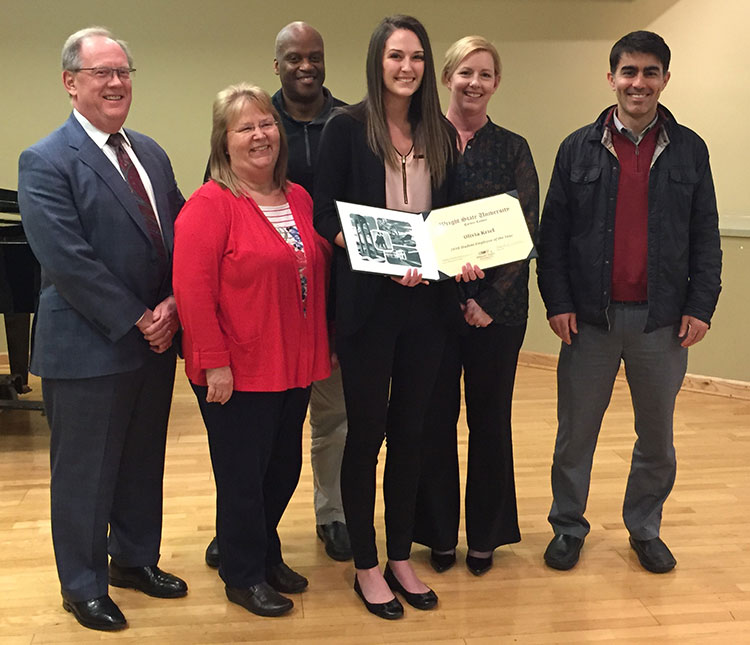 Photograph of Student Employee of the Year Olivia Kriel with five colleagues from the Wright State Research Institute.