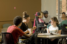 Several students sitting at a table talking