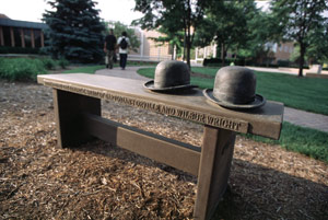 photo of wright brothers hats on bench