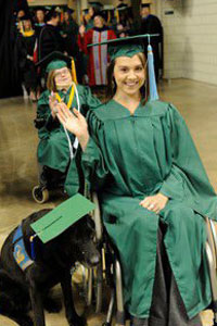 photo of graduate and service dog