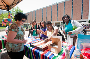 photo of students at a vendor table