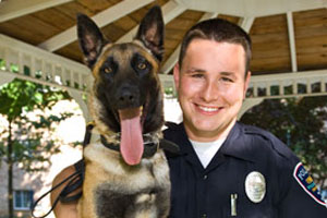 photo of police offier and dog
