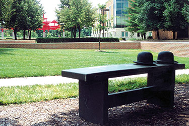 photo of the wright brothers hats on a bench on campus