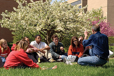 photo of a professor and class outdoors