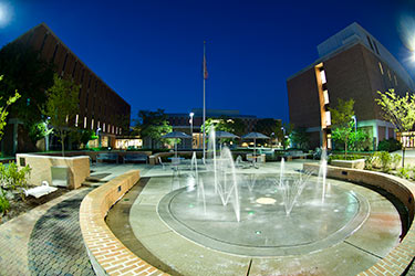 photo of the fountain on campus at night