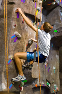 Photo of Student Climbing Rockwall