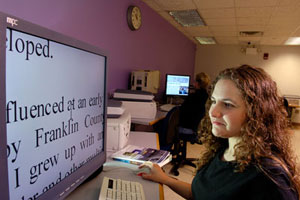 photo of a student using the adaptive computer lab