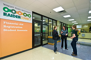 photo of students and a staff member outside of RaiderConnect