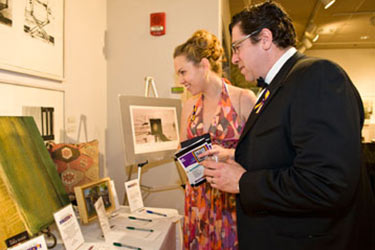 photo of guests at the artsgala silent auction