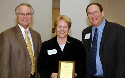 Political Science professor Donna Schlagheck with Provost David Hopkins, left, and Douglas Nord, Director of the University Cent