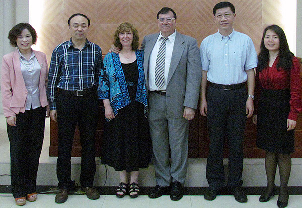 Six people standing for photos: Dr. Gomez-Cambronero and his wife, Teresa Madrid, with their Chinese hosts
