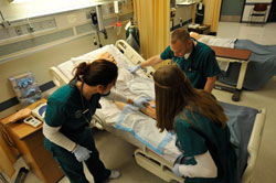 Students working on patient
