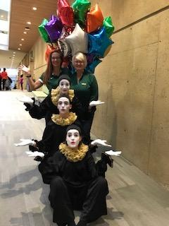 Three mimes and two staff members plus balloons