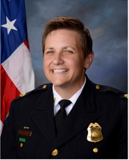 Picture of Major Wendy Stiver in Police uniform with American flag over right shoulder