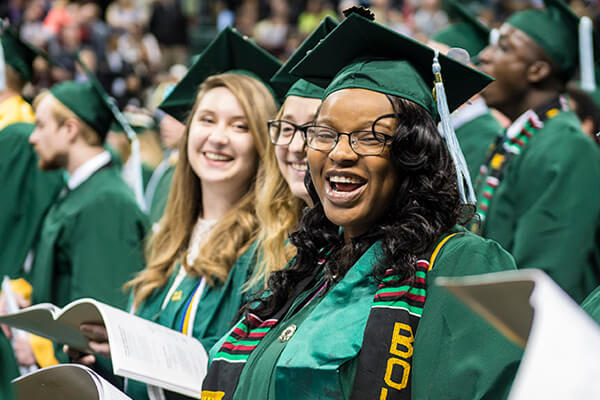 Women smiling at their commencement