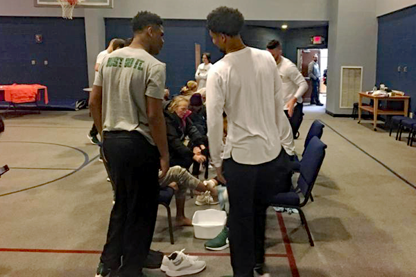 Basketball players at Samaritan's Feet event