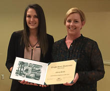 Photograph of Student Employee of the Year Olivia Kriel with her supervisor Liz Wiesman, holding the award certificate.