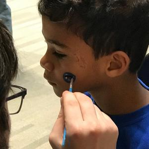 Child's face being painted