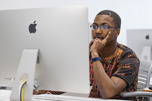 Student studying at a desktop