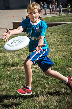 photo of a boy catching a frisbee