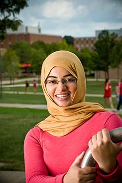 photo of a student outside on campus