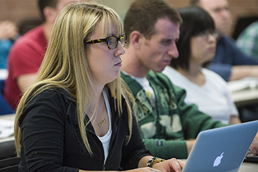 photo of a student using a laptop in class