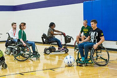 photo of students playing indoor soccer