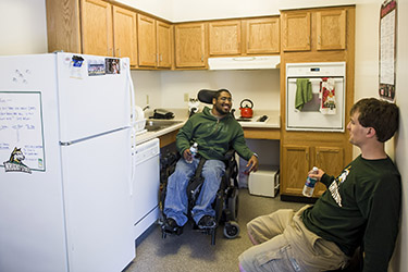 photo of two students in an apartment